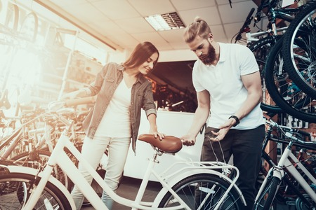 Young Girl Chooses City Bike in Sport Store. Stockfoto