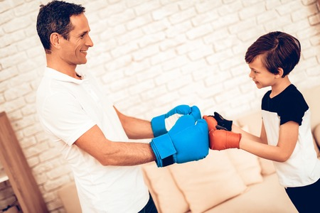Boy with Man. Father and Son Boxer. Sport at Home. Stock fotó