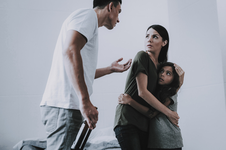 Angry Man Arguing with Scared Wife and Daughter.