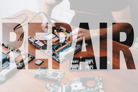 Male Hands Fix Laptop Component.