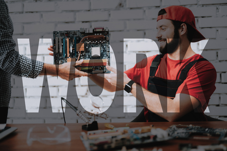 Happy Worker Receives a Motherboard. Stock Photo