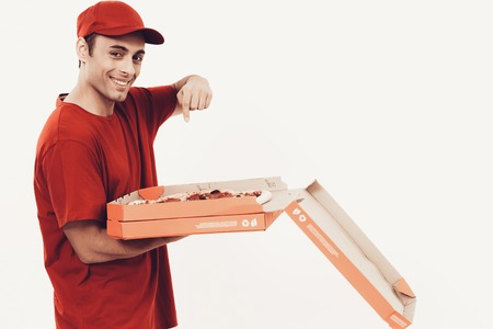 Courier Delivery. Man Deliveryman Opening Pizza Box. Worker Man Arab Nationality. White Interior. Deliveryman Arab Nationality. Courier in Orange Clothes. Express Delivery. Courier on White Background