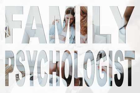 Difficult Teenager. Family Problem. Conflict Between Mother and Daughter. Mother and Daughter are Sad. Mother Hugging His Daughter. Psychologist Writing Something. People Located in Office.