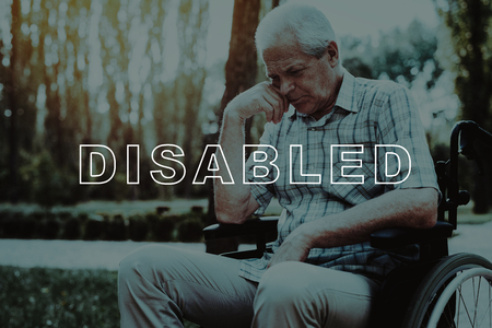 Disabled in Wheelchair. Pensively Old Man in Wheelchair. Pensioner in Sunny Park. Retirement in Nursing Home. Outdoor Rehabilitation. Sick Old Man. Old Man in Sunny Park. Old Man Retirement.