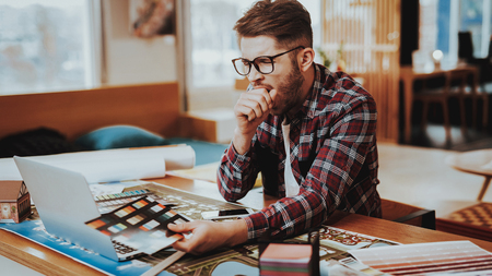 Yawning Graphic Designer Holds Color Palette. Portrait of Tired Sleepy Young Caucasian Freelancer Wearing Glasses Sits on Workplace