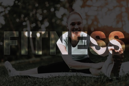 Female Drags to Feet. Girl Doing Stretching on Rug. Yoga in Park. Young Fitness Woman. Girl in Fitness Training. Female Do Exercises in Park. Person Leads Healthy Lifestyle. Woman Smiles.