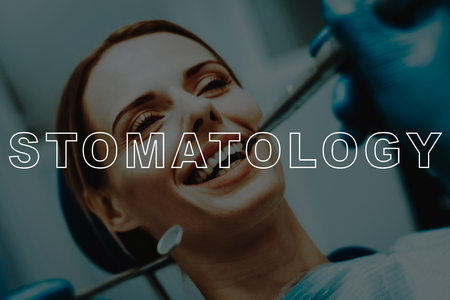 Dentist use Dental Equipment. Blue Gloves. Patient Visit Stomatology. Dentist Examine Teeth. Woman Sit in Dental Chair. Smiling Girl. Dentist Instruments. Oral Care. Dental Clinic. Tooth Healthcare.