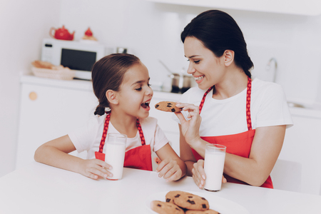 Childhood in Kitchen with Mom Bake a Sweet Cake. Little Girl and Mom Cook. Good Mood and Happy Day With Mom. Good Family Day. Joi Kid Play with Mom. Smile and Good Mood with Mother. Mother and Girl.
