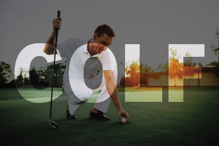 Golf Club Member Plays. Man Installs Ball on the Tee. Professional Sports Equipment. Player is Sitting, Squatting. Golfer is Teeing a Ball. Green Fresh Meadow. Luxury Active Recreation. Elite Sports.