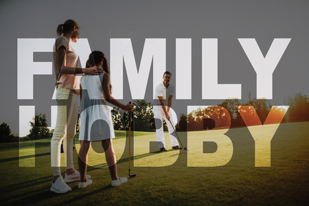 Family of a Golf Players. Golfers Have Fun Together. People Have Sports on Sunny Fairway. Summer Weekend. Family Hobby. Elite Sports. Concept of Family Happiness, Positive Atmosphere.