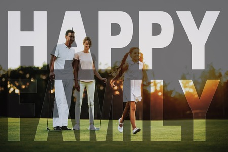 Happy Family Leisure. Golfers Walk Together with Golf Clubs. Man, Woman and Child. Parents and Kid Enjoy the Recreation. Concept of Family Relationship. Green Fairway in Sunny Day. Summer Weekend.
