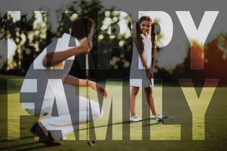 Young Child Takes Golf Shot. Happy Daughter with Golf Club. Father Teaches the Kid. Happy Family. Summer Weekend Together. Dad Spend Time with Kid. People with Golf Clubs. Elite Sports. Sunset View.