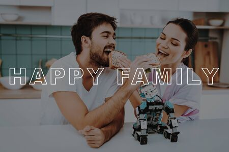 Small Robot in Front. Family Feed Each Other. Couple Eat Sandwiches. Happy Family Sit in Kitchen. Bubbly Relationships. Girl Care about Boyfriend. Guys Have Lunch Break.