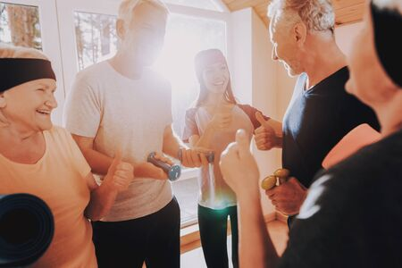 Patients in Sport Uniform. Instructor Show Thumbs Up. Smiling Patient. Active Retiree with Equipment. Elderly People Engaged. Nursing Home. Therapeutic Gymnastics. Old People Healthcare Lifestyle.