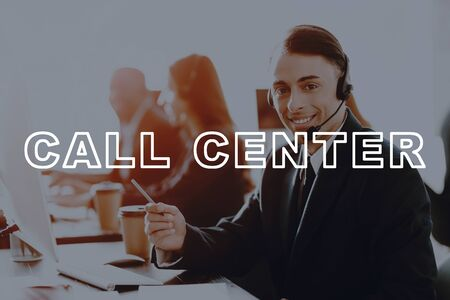Call Centre Workplace. Smiling Office Employee. Professional Operator. Young Man Agent. Customer Service .