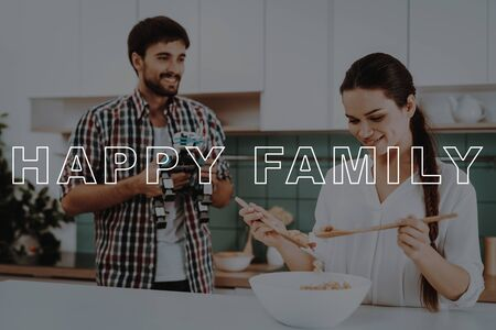 Girl Prepare Salad. Bubbly Relationships. Young Couple at Home. Woman Preparing Breakfast. Smiling Couple.