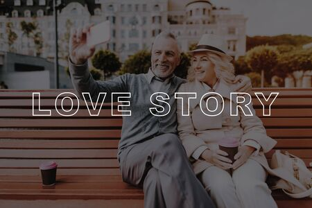 Pensioners Couple Selfie. Woman in Hat. Pensioners Rest in Park. Old Couple Bubbly Relationships. Couple Love Story. Woman Smiling. Old People on Date. Retired People Sit on Bench.