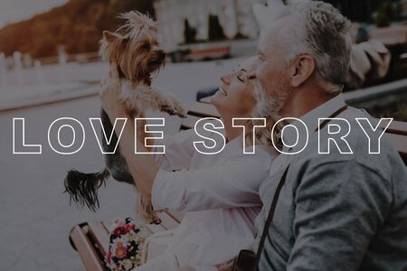Old People on Date. Woman Smiling. Two Pensioners with Little Dog. Old Couple Love Story. Old Couple Bubbly Relationships. Retired People Happy Together. Retired People Sit on Bench.