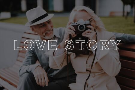 Retired People Spend Leisure Time. Couple Love Story. Old People Date. Woman Smiling. Old Couple Hugs. Woman Hold Film Camera.  Old Couple Bubbly Relationships.