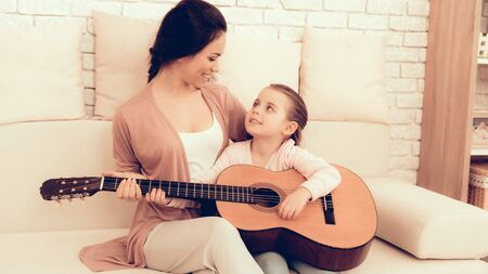 Kids Home Games. Rest at Home. Child Development. Mom and Daughter Play. Playing Guitar at Home.
