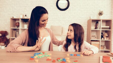 Woman Teaches Girl. Educational Games. Learning Child at Home. Child Development. Board Games for Children. Modern Learning for Children.