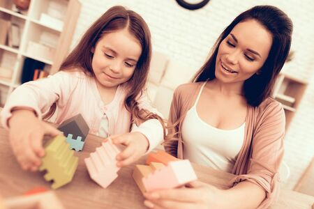 Mother Teaches Daughter. Educational Games. Learning Child at Home. Cost House of Cubes. Cubes and Puzzles. Child Development.