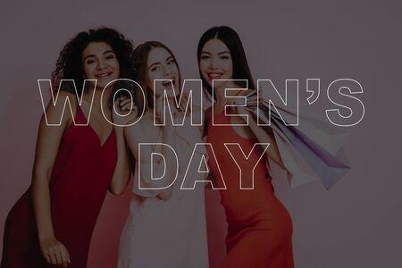 Girls in Dress. Pink Background. Celebrating Women's Day. March 8. Smiling Girls. Surprised Women. Happy Women. Happy Emotions.