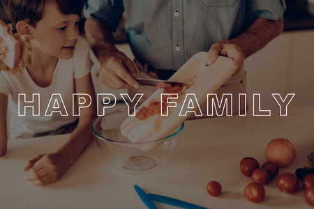 Happy Family Cooking Salad. Boy Eat Sandwich. Guy Use Kitchen Knife. Grandson and Grandfather Have Fun. Thanksgiving Day. Relatives Together at Home. Relatives Cooking Traditional Dinner. Imagens