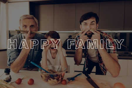 Guys with Mustache from Green. Thanksgiving Day. Happy Family Cooking Salad . Relatives Together at Home . Grandson and Grandfather Have Fun . Relatives Cooking Traditional Dinner. 版權商用圖片
