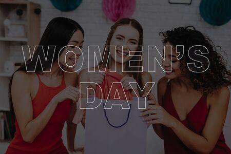 Girls in Dress. Celebrating Women's Day. March 8. Smiling Girls. Surprised Women. Happy Women. Happy Emotions. Women Spend Good Time. Beautiful Women. Show a Holiday Gift . Best Girlfriends.