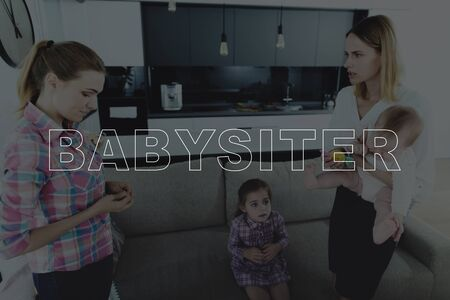 Mother Come Back to Home. Mother Unhappy of the Nanny. Mother Holding a Baby Daughter. Other Daughter Sitting on Couch. Nanny is Sad and Listening a Mother. People Located in Living Room. Фото со стока