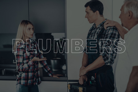 Two Male Plumbers are Working. Plumbers is Adult Guy and Old Man.
