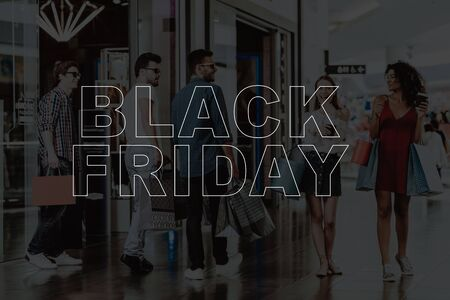 Young Company Shopping At The Mall. Black Friday. Weekend Activities. Big Discounts. Look At Purchases. Bags With Clothes. Rush Of Customers. Holiday Sales. Stylish Teenagers In Glasses.