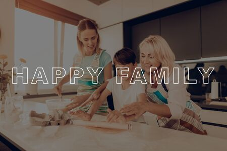 Grandmother Help Boy. Little Boy Hold Rolling Pin. Grandmother Smile. Happy Family Enjoy Cooking. Guy Knead Dough. Child Make Cookies. Happy Family Cooking. Family Thanksgiving Day.