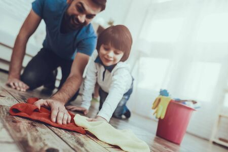 Man Spends Time with His Son. Father is Engaged in Raising Child. Father is Teaching a Son a Cleaning.
