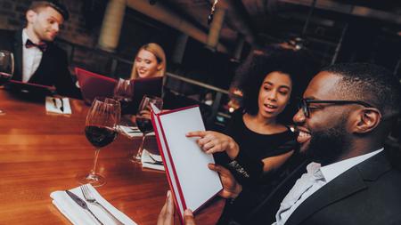 Businessmans Having Meeting In Indoor Restaurant. Group Business People Geting Order in Restaurant. Corporate, Collaboration Concept. Team Professional Worker. Teamwork. Holding Menu.