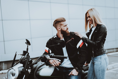 Man And Women Are Sitting On Motorcycle. Going For Ride. Fashion Riders. Confident Staring. Speed Vehicle. Biker With A Beard. Motorbike Concept. Classic Style. Ready To Drive. Tripping Together. Stock Photo - 113739761