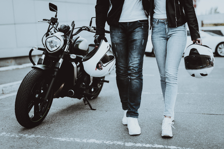 Man And Women Bikers With Helmet. Motorbike Concept. Ready To Ride. Classic Style. Tripping Together. Street Vehicle. Journey Transport. Riders Couple. Jeans And Jackets. Sunny Day. Stock Photo - 113739955