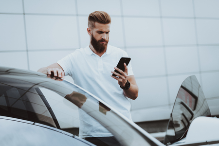 Man Talks On Phone Near Car. Charge Station. Automobile Parking Lot. Innovation Technology. New Generation Electro Hybrid Vehicle. Ecology Station. Futuristic Power. Gadget Concept.