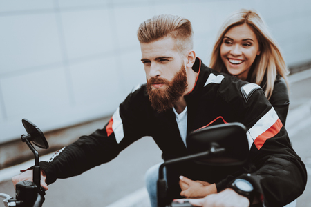 Man And Women Are Riding A Bike. Bikers Concept. Going For Ride. Fashion Riders. Confident Staring. Speed Vehicle. Biker With A Beard. Motorbike Concept. Classic Style. Tripping Together.