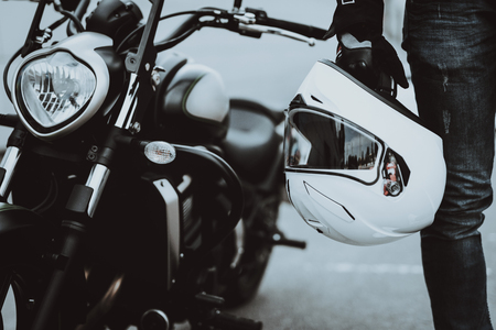 Rider Stands With Helmet. Motorbike Background. Ready To Ride. Power Engine. Leather Seat. Motorcycle Steering. Bike Headlight. New Generation. Street Vehicle. Journey Transport. Classic Style.