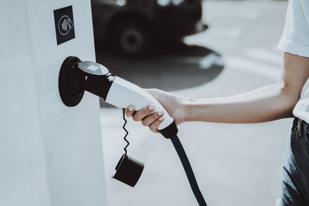 Electric Car Cable Plug In A Socket. Automobile Charging Station Concept. Innovation Technology. New Generation Electro Hybrid Vehicle Plugin. Ecology Charge Station. Futuristic Power. Reklamní fotografie