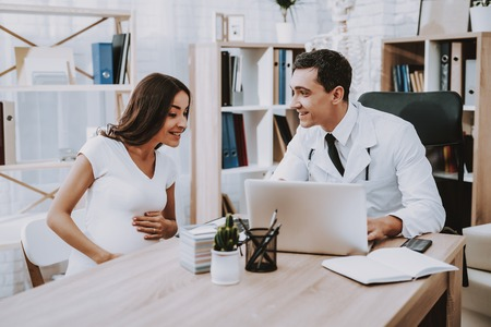 Doctor Showing Something on Laptop to Woman.