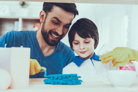 Father and Son Wipe the Furniture Surfaces from Dust