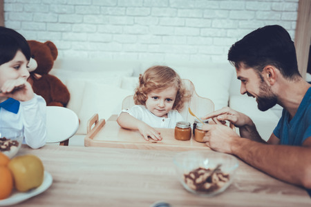 Man Spends Time with His Sons. Father is Feeding His Sons. Reklamní fotografie