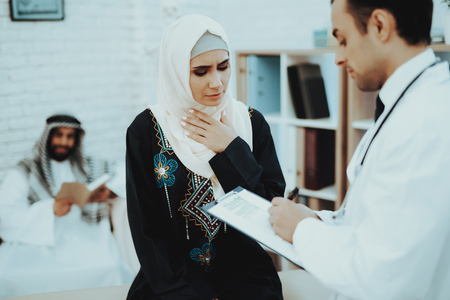 Arabic Male Doctor Examining a Muslim Woman.