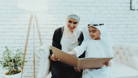 Arabic Mother with Son Wait for Doctor in Clinic. Patients In Doctors Waiting Room. Consultation at Clinic. Reception of Therapist. Examination. Medical Concept. Waiting For Pediatrician. 写真素材