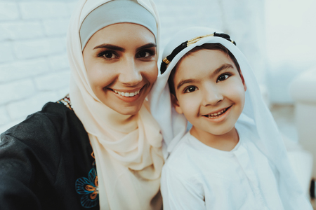 648ae067ee9 Happy Muslim Mom with Little Son Making Selfie. Arabic Mother with Boy  Doing Selfie in