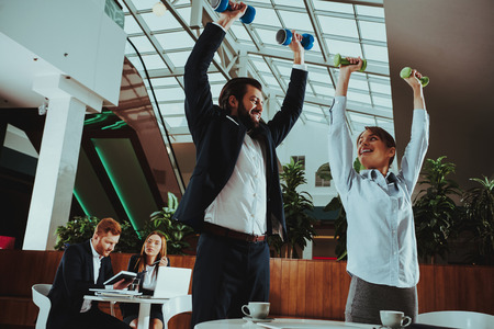 Corporate Sport Lifestyle. Healthcare of Business People. Office Workers Working with Dumbbells. Workers doing Fitness Exercises. Yoga Practice. Employee Man Smiling to Healthy Woman.