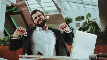 Healthcare of Business People. Office Worker doing Fitness Exercises. Happy Office Manager. Worker in Suit. Time Management. Work with Laptop. Man Warming Up at Work. Office Interior. Zdjęcie Seryjne